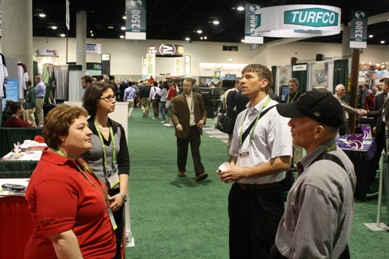 fran koppell, sabrina tirpak and students at the rutgers turf booth