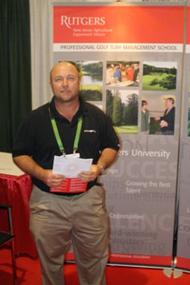 Camarillo Springs Golf Course Superintendent Daniel Warne standing in front of the Rutgers Turf Management School Booth